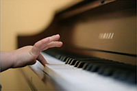 small hand on piano