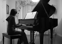 teen girl playing piano